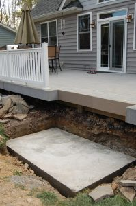 DIY concrete pad deck level outdoor fireplace