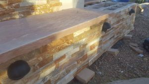 Flagstone seating material and lighting on a DIY outdoor fireplace
