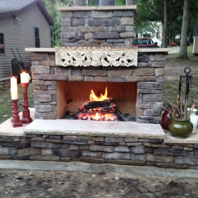 Stone seating on DIY outdoor fireplace