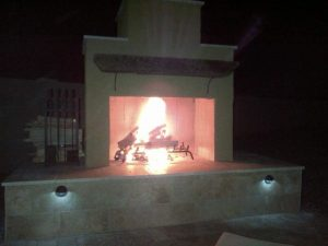 Pima II outdoor fireplace with lights and fire