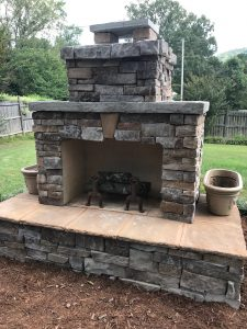 DIY outdoor fireplace planter grass fence mulch chimney hearth fire grate firewood backyard