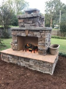 DIY outdoor fireplace mulch backyard grass fire grate planter veneer flagstone chimney