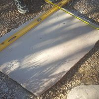 level measuring tape flagstone cutting with a diamond blade
