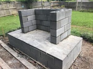 cinderblock concrete slab diy outdoor fireplace grass backyard