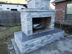 DIY outdoor fireplace with veneer and tile