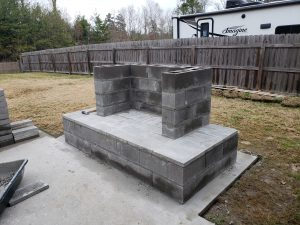 DIY outdoor fireplace plan cinder block mortar