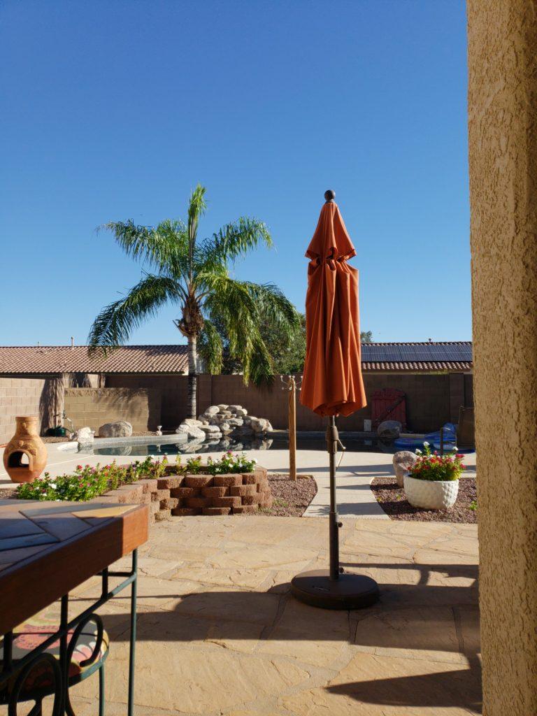 improve the look swimming pool umbrella palm tree flagstone planter