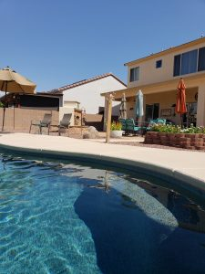 swimming pool patio umbrella fireplace deck planter