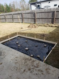 DIY outdoor fireplace concrete pad extension