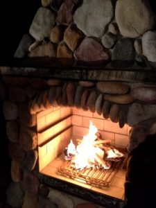 DIY outdoor fireplace with fire