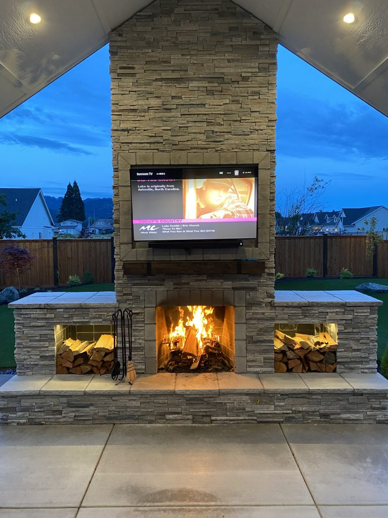 DIY outdoor fireplace TV pergola