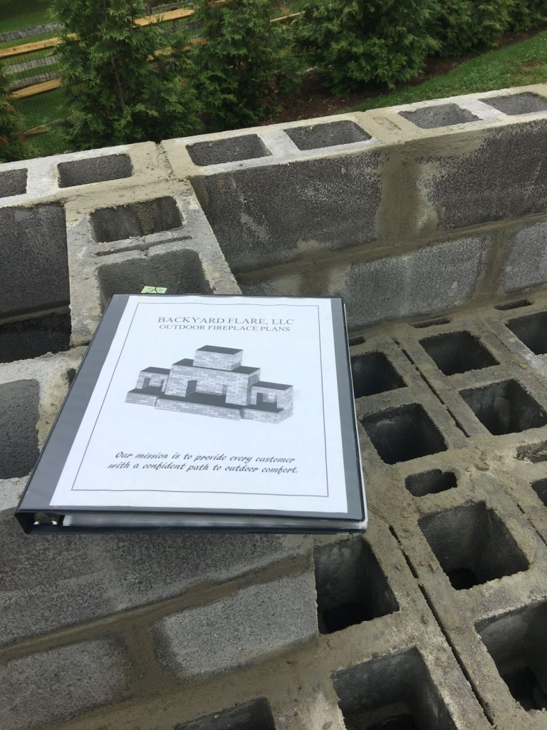 Cinder block DIY outdoor fireplace with construction plan